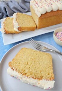 A slice of Vanilla Loaf Cake on a small plate