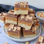 A stack of Snickers Millionaire's Shortbread