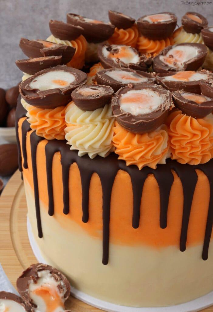 A close up of the Creme Egg Drip Cake